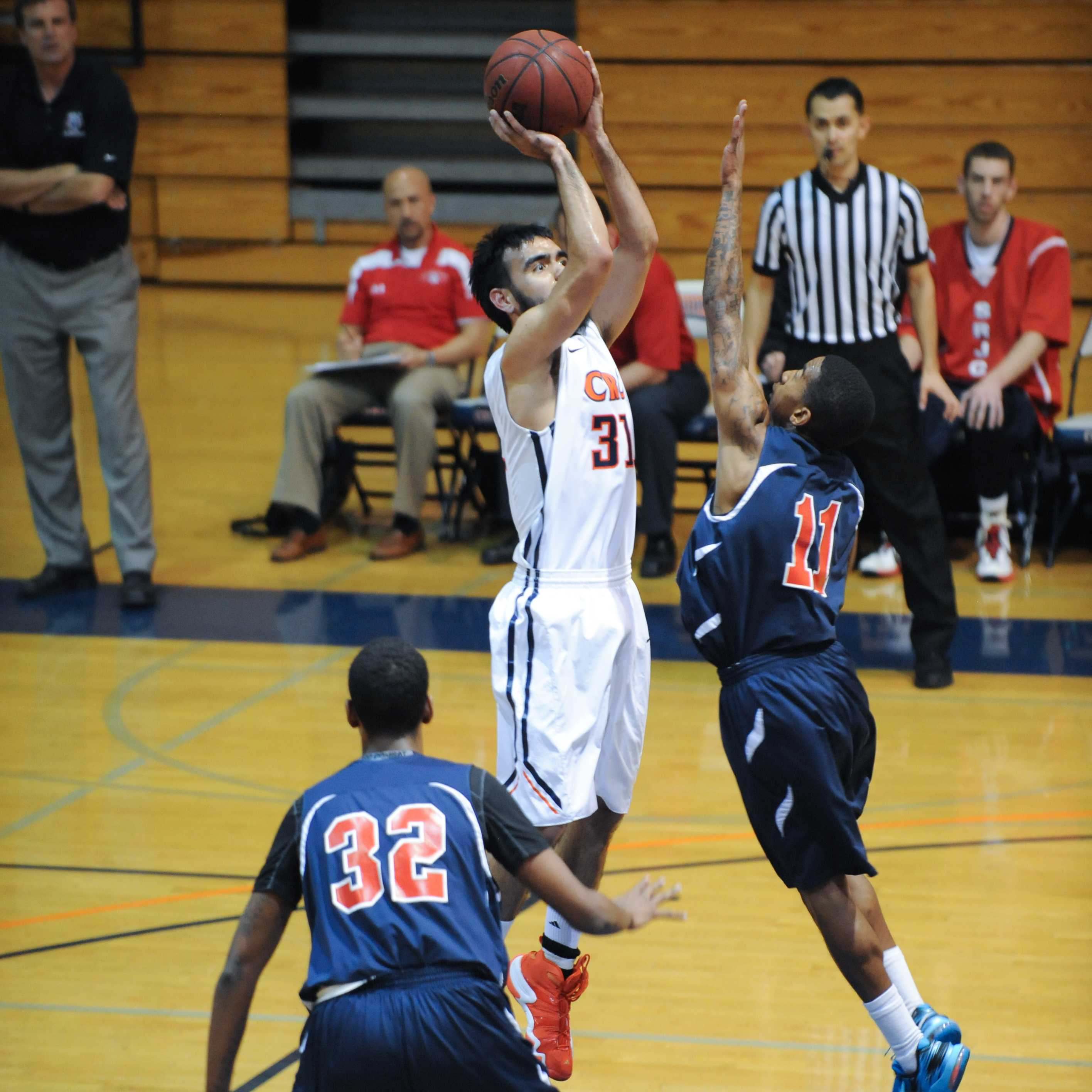 Sophomore guard Josh Dela Cruz playing at the Big 8 conference on Feb. 20.