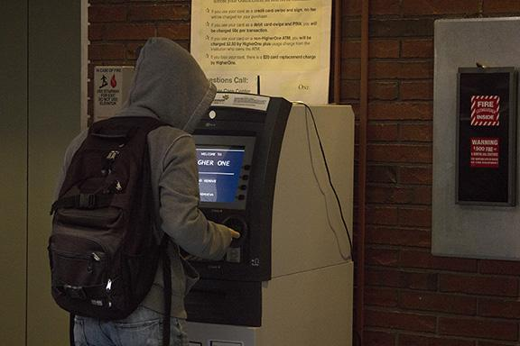 A student uses the Higher One ATM in CRC's library building. Some students have reported problems with the ATM working correctly.