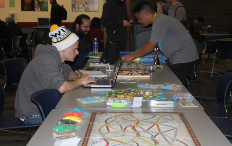 Members of the Kingdom Builders including founder and President Richard Spark, pictured second on right, meet in the cafeteria on Thursdays to play various strategy games like Settlers of Catan and Ticket to Ride.