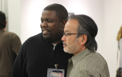 Illustrator and former student Robert Love (left) was one of the four artists contacted by art Professor Yoshio Taylor (right) to take part in the third show at CRC's Art Gallery opening on March 6.