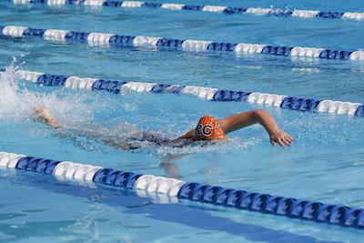 Freshman swimmer Megan Lapomardo competing in the 100 meter freestyle at the Big 8 Invitational at America River College on March 13.
