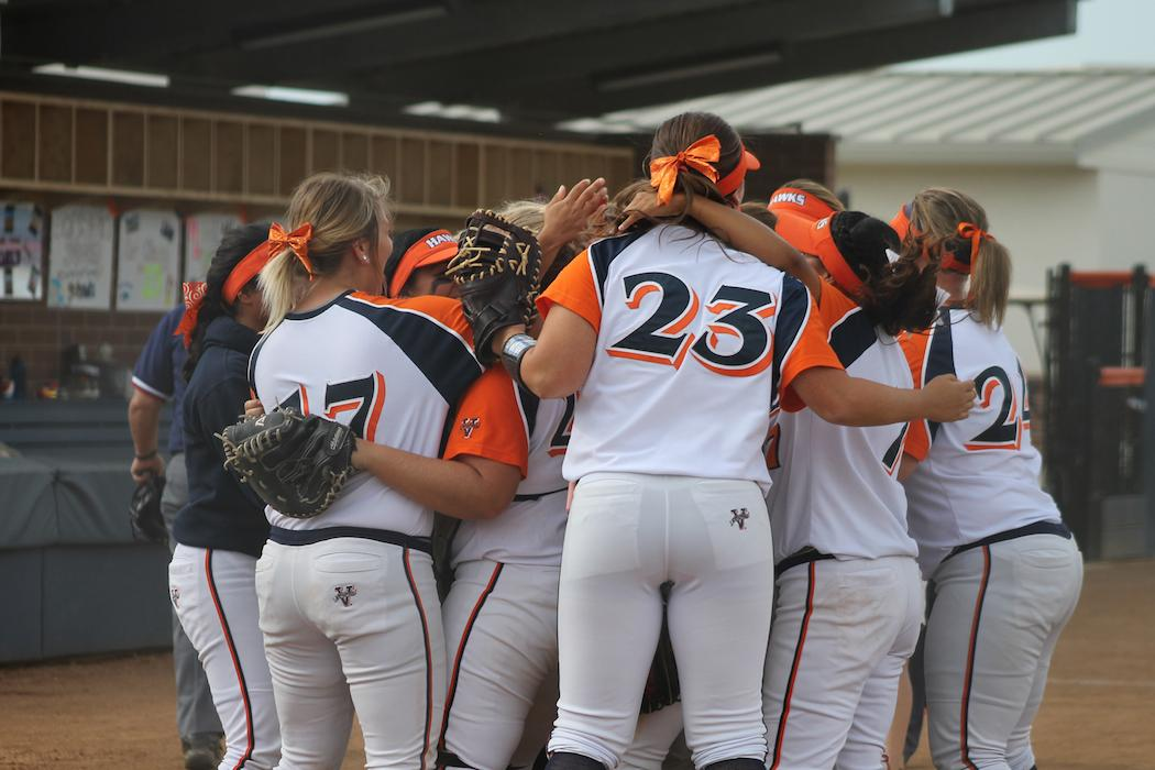 The softball team celebrating after defeating DVC 6-2 during their Big 8 Conference.