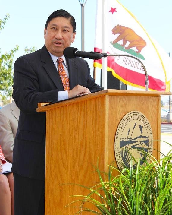 Interim President Whitney Yamamura speaks to faculty members and guests at the dedication of the Elk Grove Center in August 2013. As Vice President of Instruction and Student Learning, Yamamura played a key role in the formation of the center.