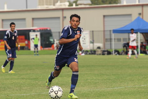 Defender Jose Alvalardo sprints down the field to catch a pass. The Hawks lost 3-1.