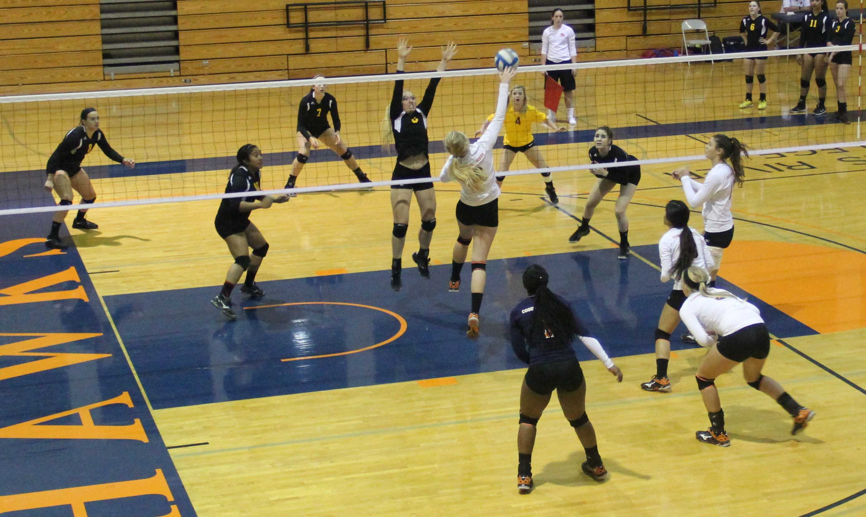 Justice Cooper, outside hitter, goes for a spike on the ball during a tournament hosted at CRC on Sept. 18.
