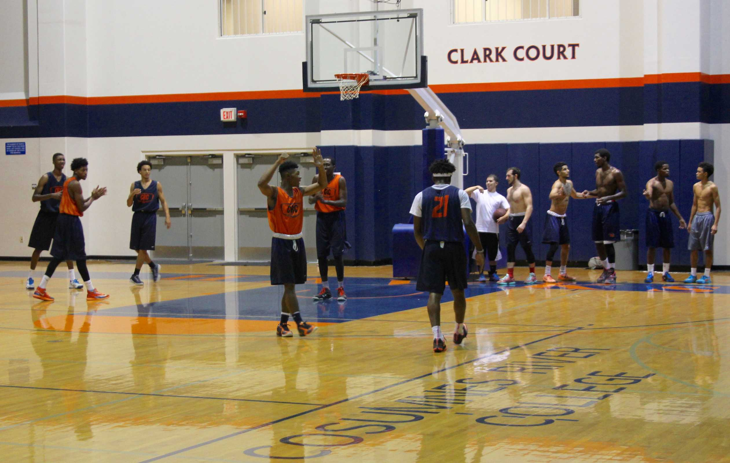 Men's basketball team practicing in preparation for upcoming season