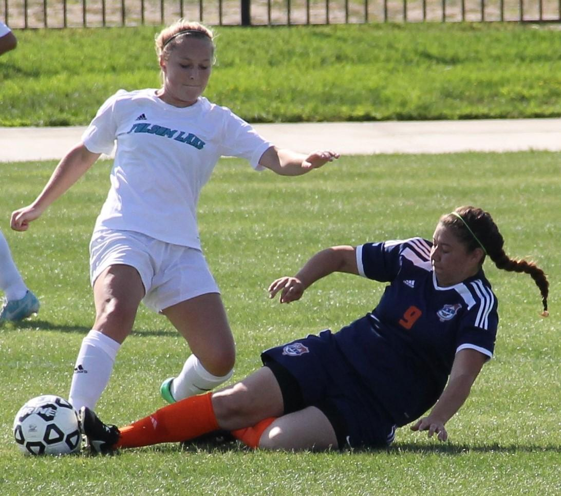 Defender Jessica DeAnda goes for the tackle on the ball and defends the goal from the Folsom Lake Falcons on Sept. 2.