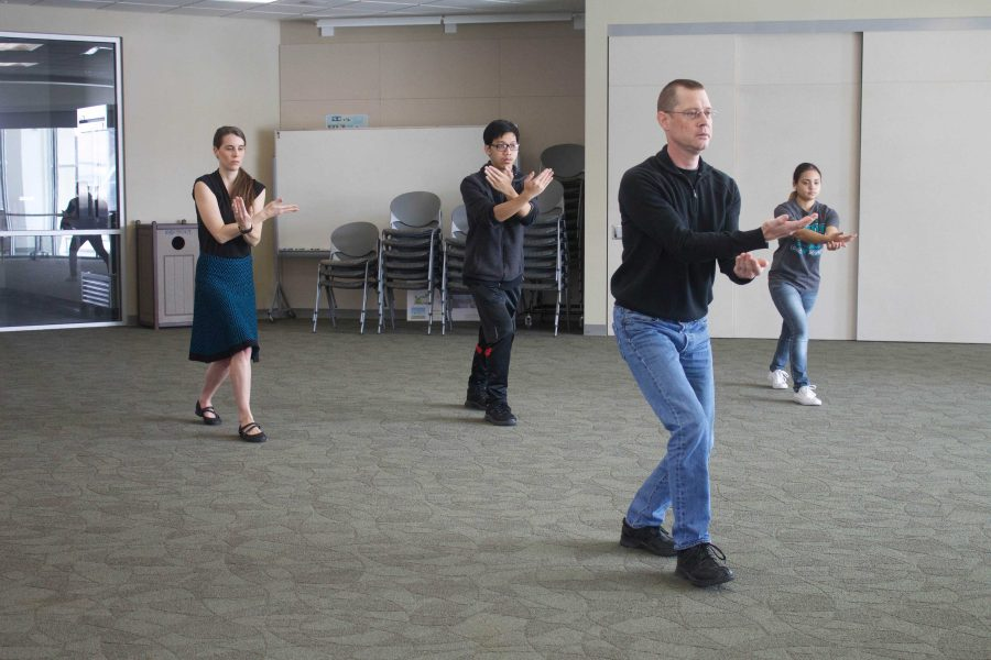 Philosophy+professor+Rick+Schubert+guides+students+and+faculty+through+a+50+minute+tai+chi+session+on+March+2.