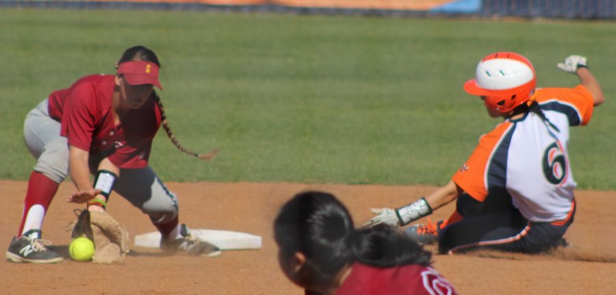 Sophomore shortstop Brenda Velasquez slides in to second base against Sacramento City College on March 22