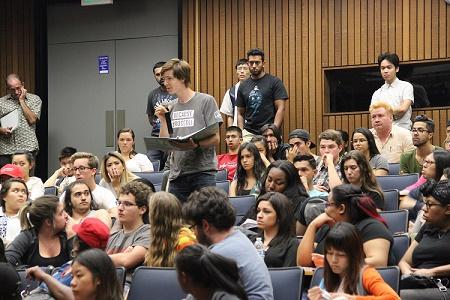 Students take part in question-and-answer forum after presidential debate viewing in L-111 on Monday.