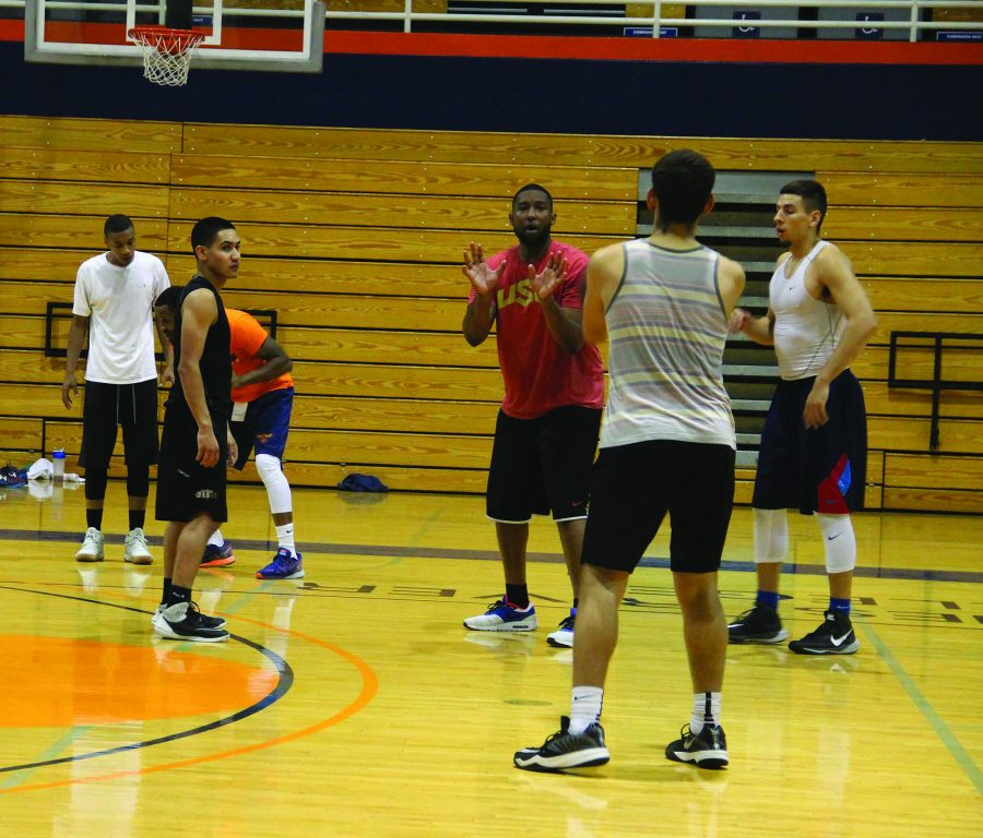 Men's basketball coach Jonathan James takes part in an evening practice session.