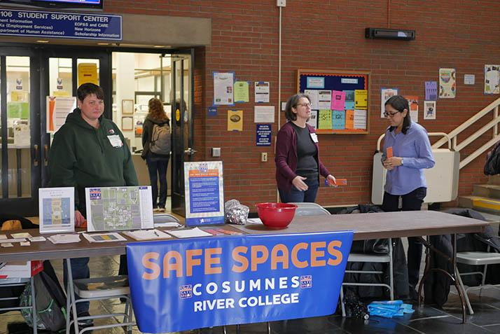 Safe Spaces Day coordinator Anastasia Panagakos (center) and faculty allies raise awareness for the Safe Spaces Program on Tuesday.