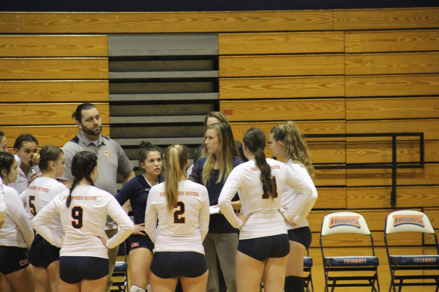 Volleyball head coach Kari Post huddles with her team during the Hawks' game against Modesto on Sept. 15.