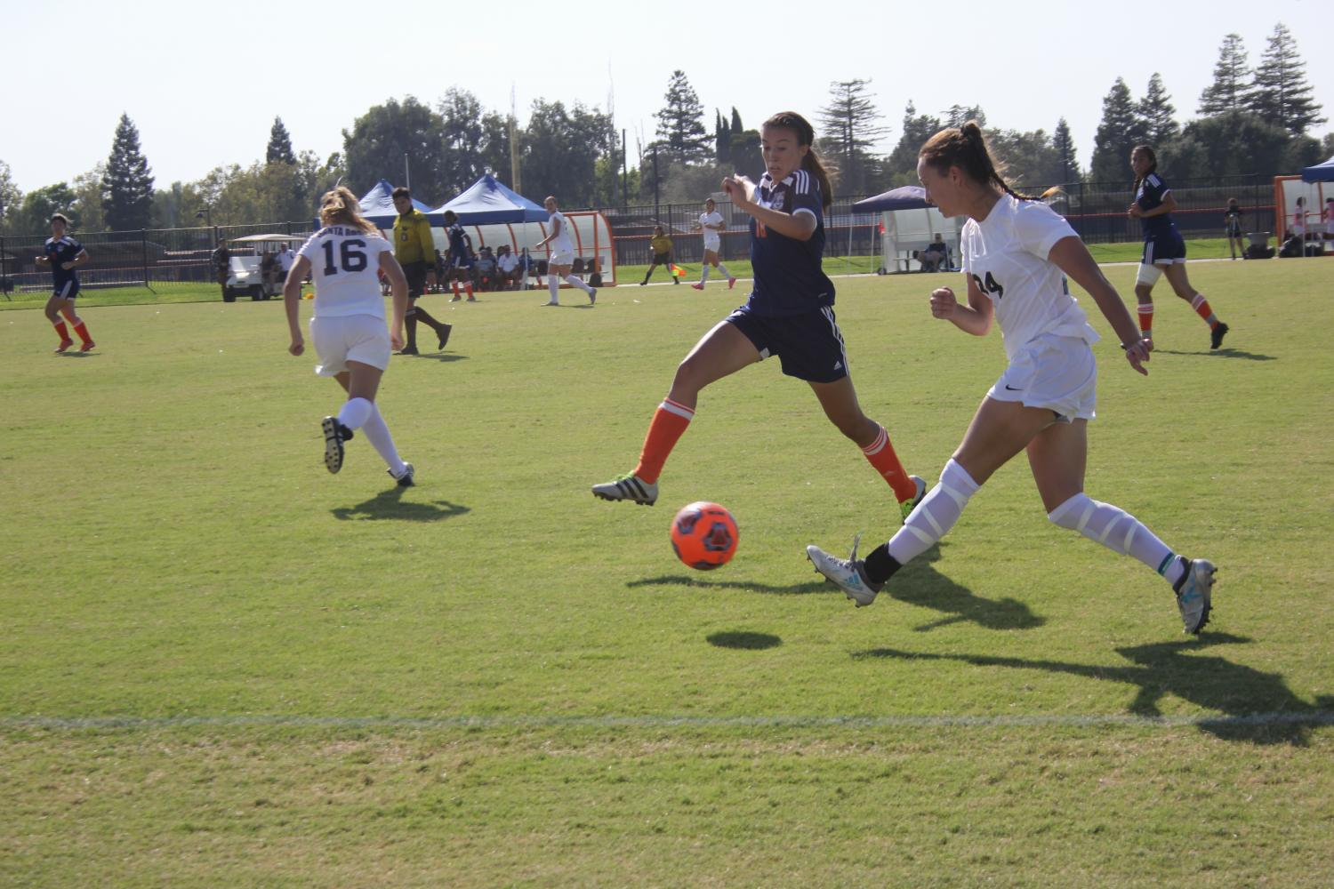 Sophomore defender Amanda Lopez fights for the ball in the Hawks' game against Santa Rosa on Sept. 15.