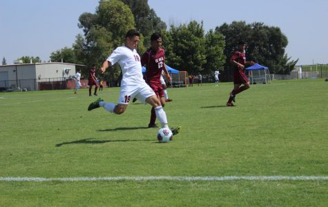 Freshman midfielder Ivan Gutierrez drives the ball at the end of the Hawks' game against De Anza on Sept. 8.