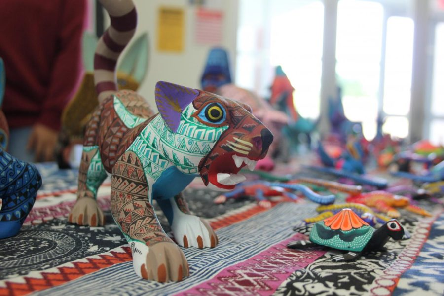 Carvings painted by Oaxacan artist Alma Arreola on display for view and potential sale on Oct. 10. Arreola's work is part of an artists' collective called Ecoalebrijes.