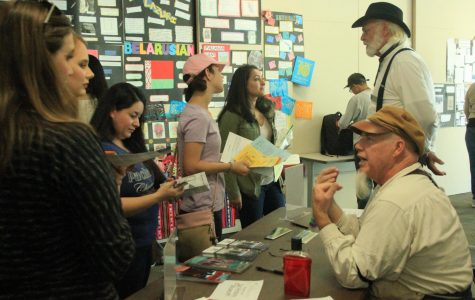 Students gather at The Sacramento History Museum's table to learn about Sacramento's past at the Anthropology Expo at Cosumnes River College on Oct. 27.