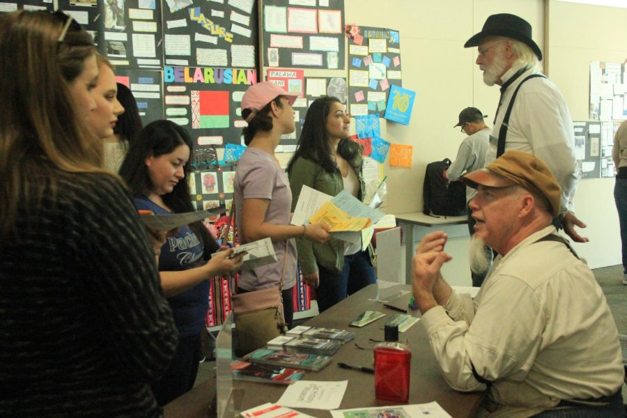 Students+gather+at+The+Sacramento+History+Museum%27s+table+to+learn+about+Sacramento%27s+past+at+the+Anthropology+Expo+at+Cosumnes+River+College+on+Oct.+27.+
