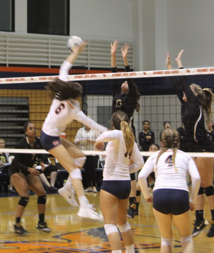 Hawks sophomore middle blocker Meg Maddalena goes for the point in Friday's game against the San Joaquin Delta Mustangs.