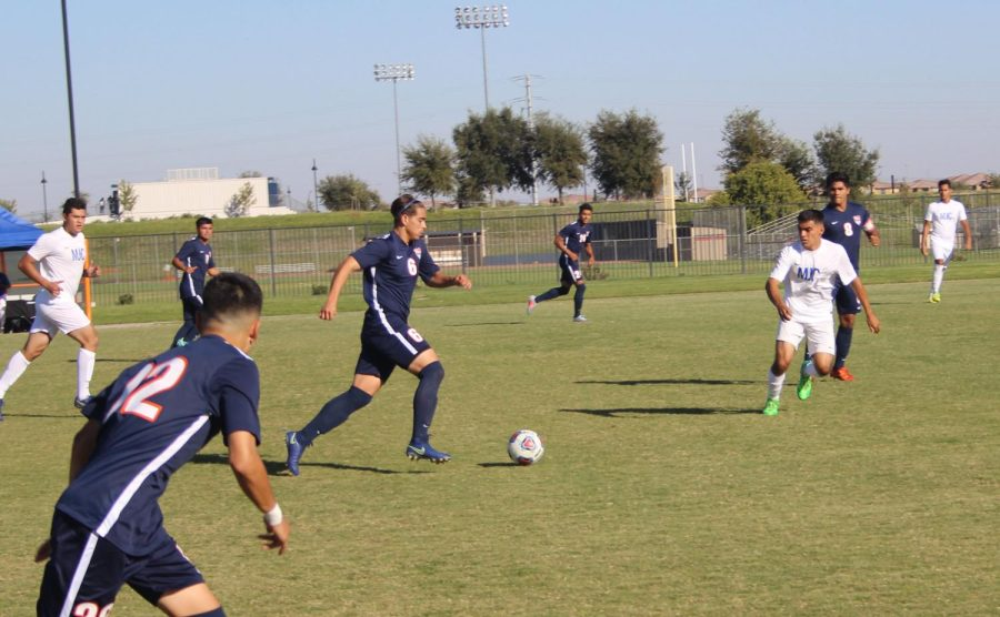 Freshman midfielder Lincoln Carvalho leads the drive in Friday's game against Modesto Junior College.