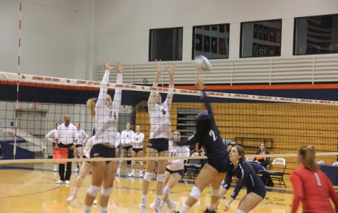 Outside Hitter Rebakkah McLaughlin (left) and Opposite Jade Griley block against the Beavers on Nov. 3.