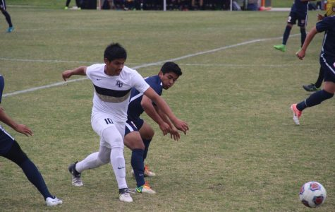 Freshman Midfielder Ivan Gutierrez blocks Delta from a potential scoring drive in the first half. The Hawks defense prevents the Mustangs from scoring a goal, resulting in a 0-0 first half.