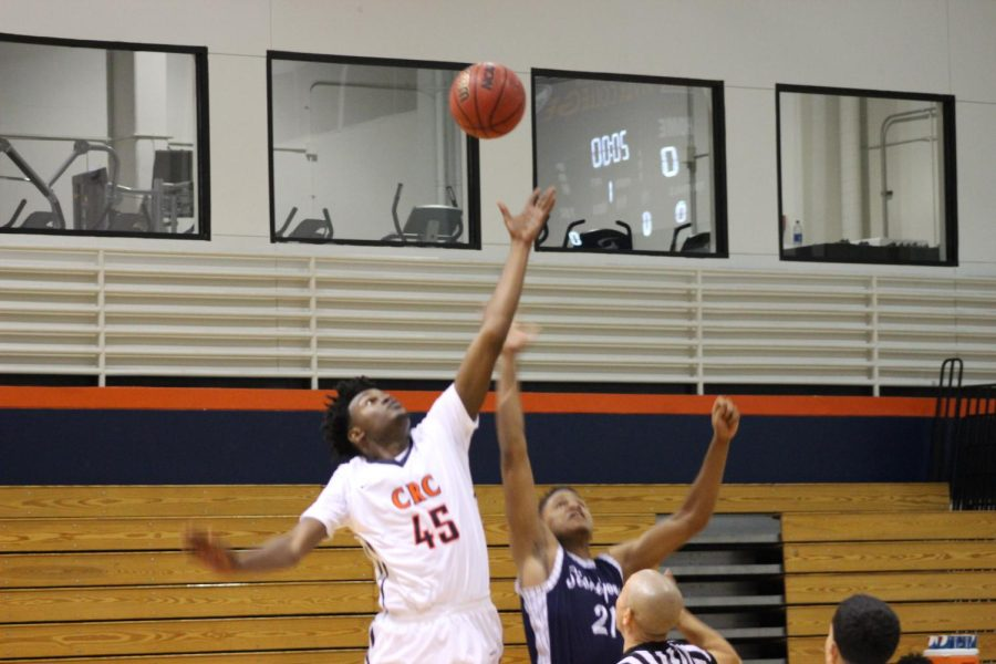 Sophomore forward Everton Maxwell participates in the tip off to start the Hawks' tournament run on Nov. 30.