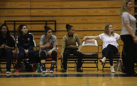 Assistant coach Jasmine Chapman, center, looking on as the Hawks play against Sierra College on Jan. 16. Chapman promoted as the new assistant coach under head coach Coral Sage.