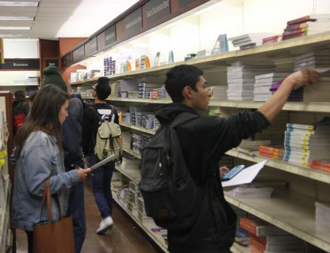 Students crowd around over at the Hawk Spot to collect their textbooks for the spring semester.
