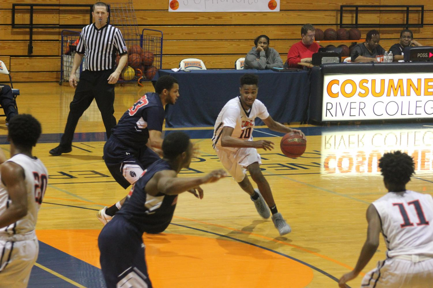 CRC sophomore guard Jordan Roberson passes through freshman Malcom Jenkins to attack the rim and score in the Big 8 matchup on Feb.9