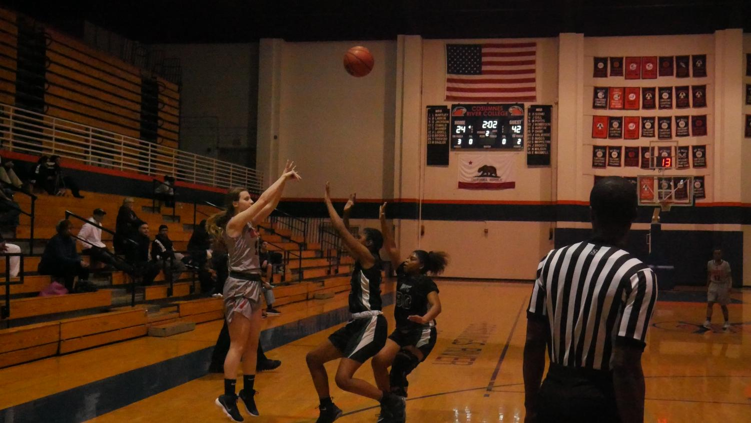 Guard Trina Shaner shooting a three in a loss to the DVC Vikings