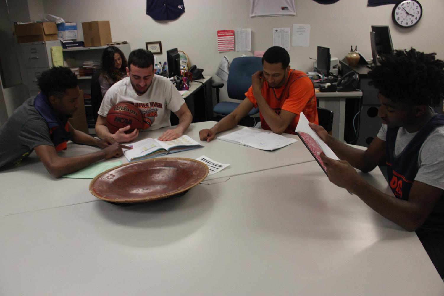 Members of the men's basketball team putting in time in the study hall in CAC 104 to keep their grades up so they can stay on the court.