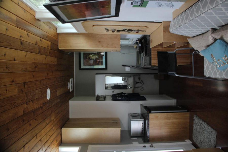Interior of the tiny house. The tiny house was build to be zero net energy, complete with radiant heat, solar panels and compostable waste toilet system.