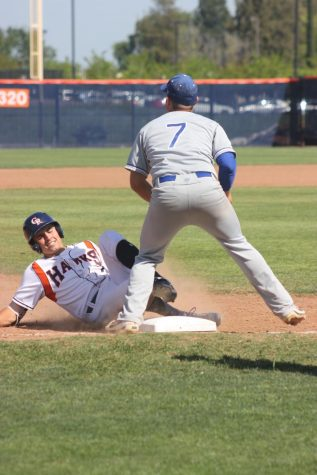 Infielder Alex Crouch slides to third base after hitting a triple for 360 ft into midfield. This play allowed utility Greg Creamer and first baseman/left hand pitcher Joey Pankratz to score on a double RBI, and the score was 5-0 in the bottom of the third inning on Tuesday.