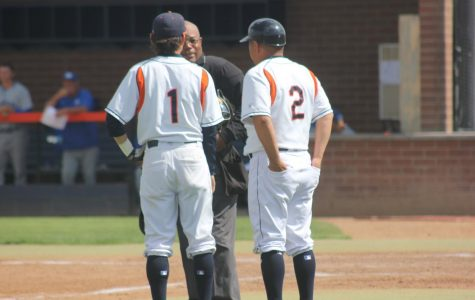 JD Mico, on the left, and Don Mico talking to the umpire during the game versus  Modesto Junior College on April 27.