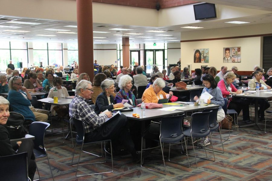 Student, senior citizens and volunteers work on their exercises and assignments in the cafeteria on April 28.