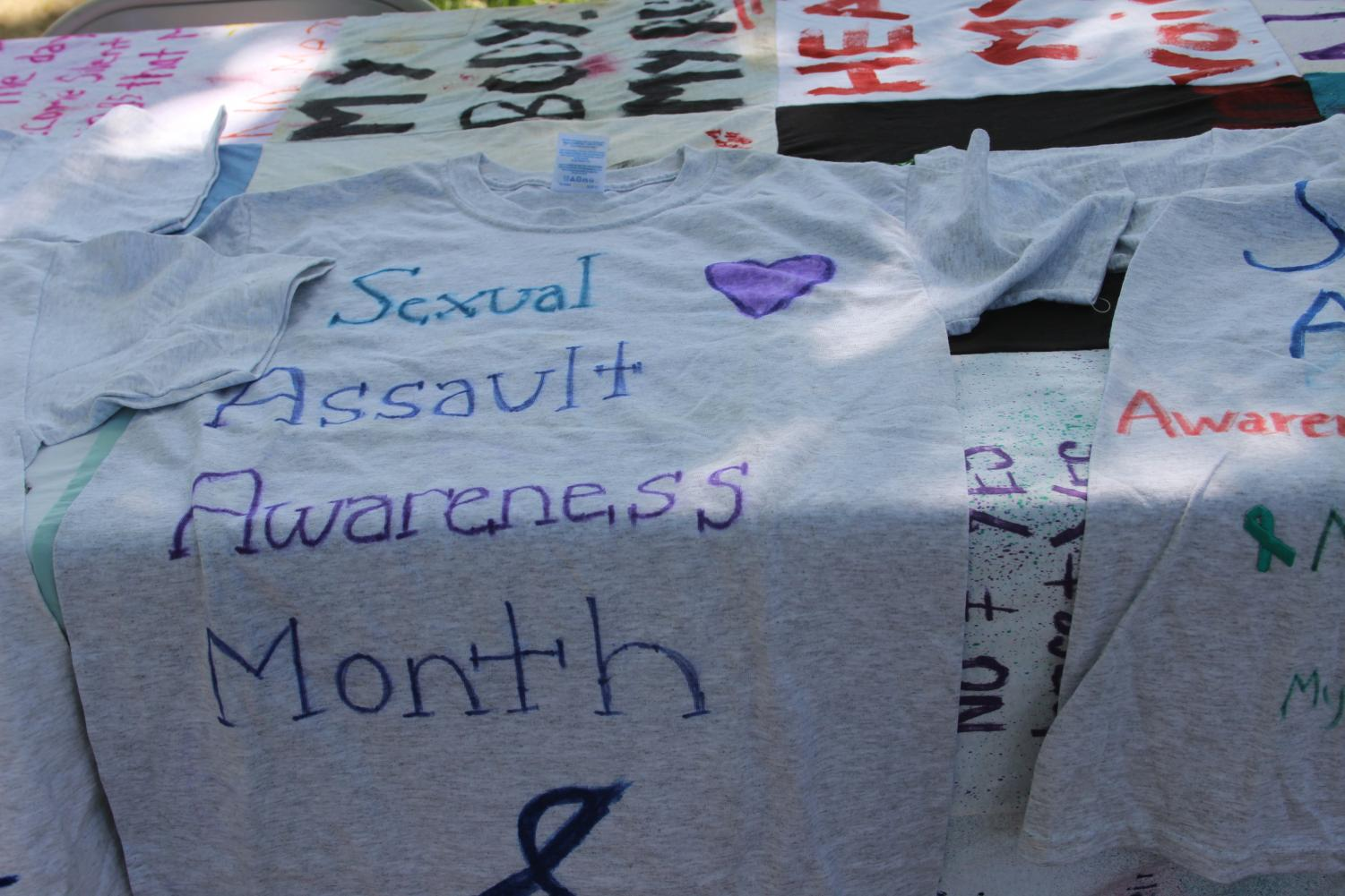Students were able to write messages on shirts from a table by the quad.