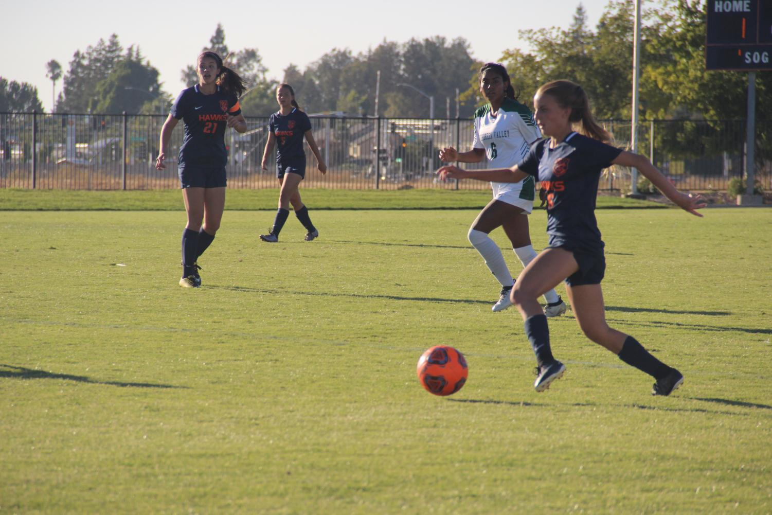 The women's soccer team has high hopes to reach the playoffs this year. Midfielder Taya Bradford, right, is one of 19 freshman on this years team.