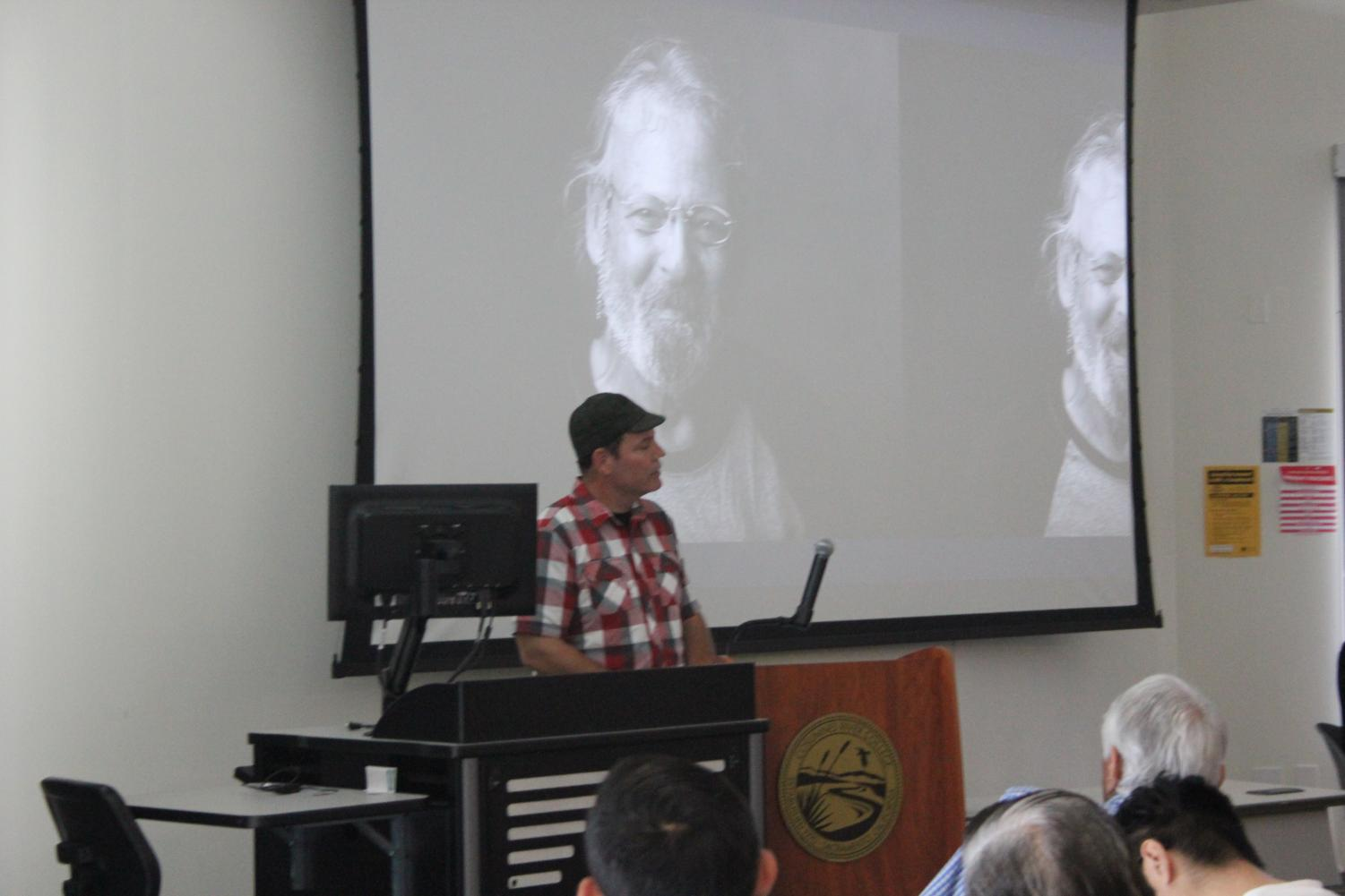 CRC student Doug Winter gives a speech about homeless people's lives to a crowd of people in the WINN Center.