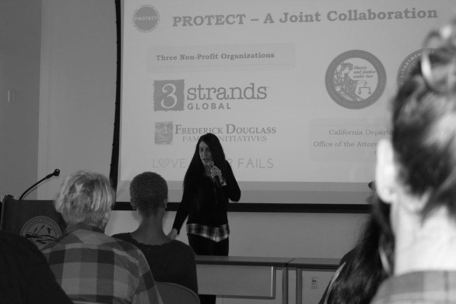3Strands Global spokesperson Melissa Zapata gives a speech about human trafficking to a group of people in the WINN Center.