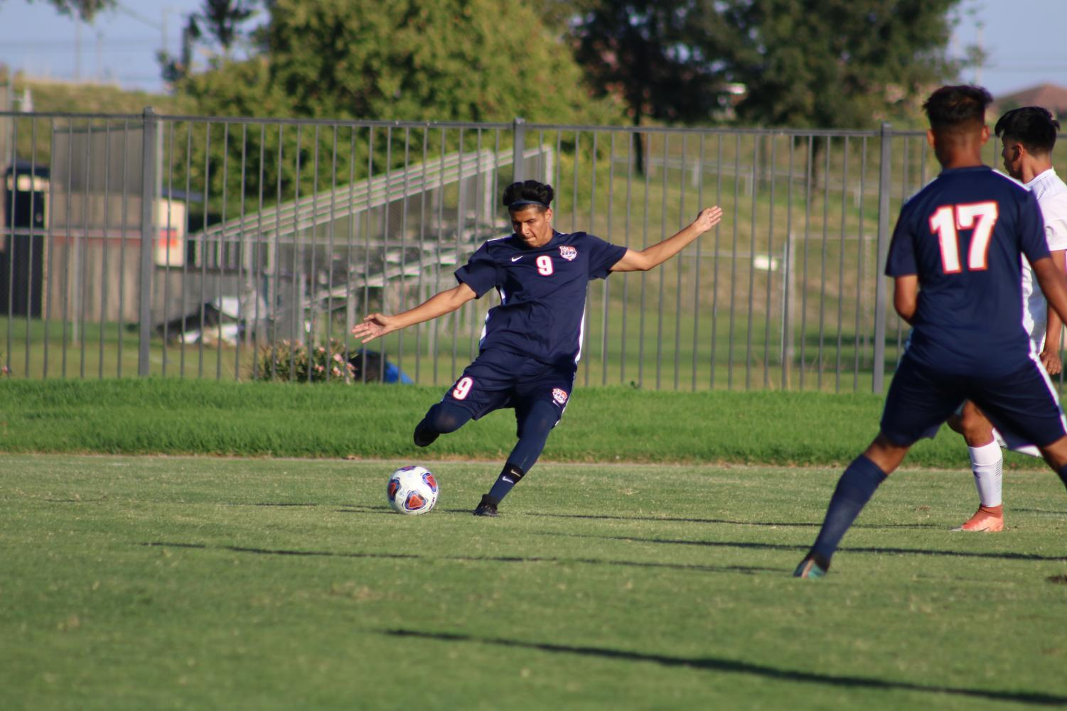 Freshman forward Daniel Ramirez moves the ball upfield in the Hawks 5-0 Victory against the College of Sequoias on Oct. 9. The Hawks have picked up power points in all four of the games in their non conference schedule over the last two weeks.
