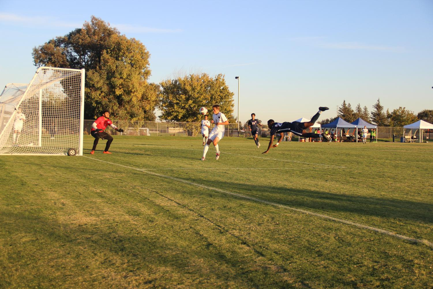 Freshman forward D.J. Emojong goes all out on a header for a shot on goal. CRC defeated Santa Rosa 2-1 coming closer to securing a playoff spot.
