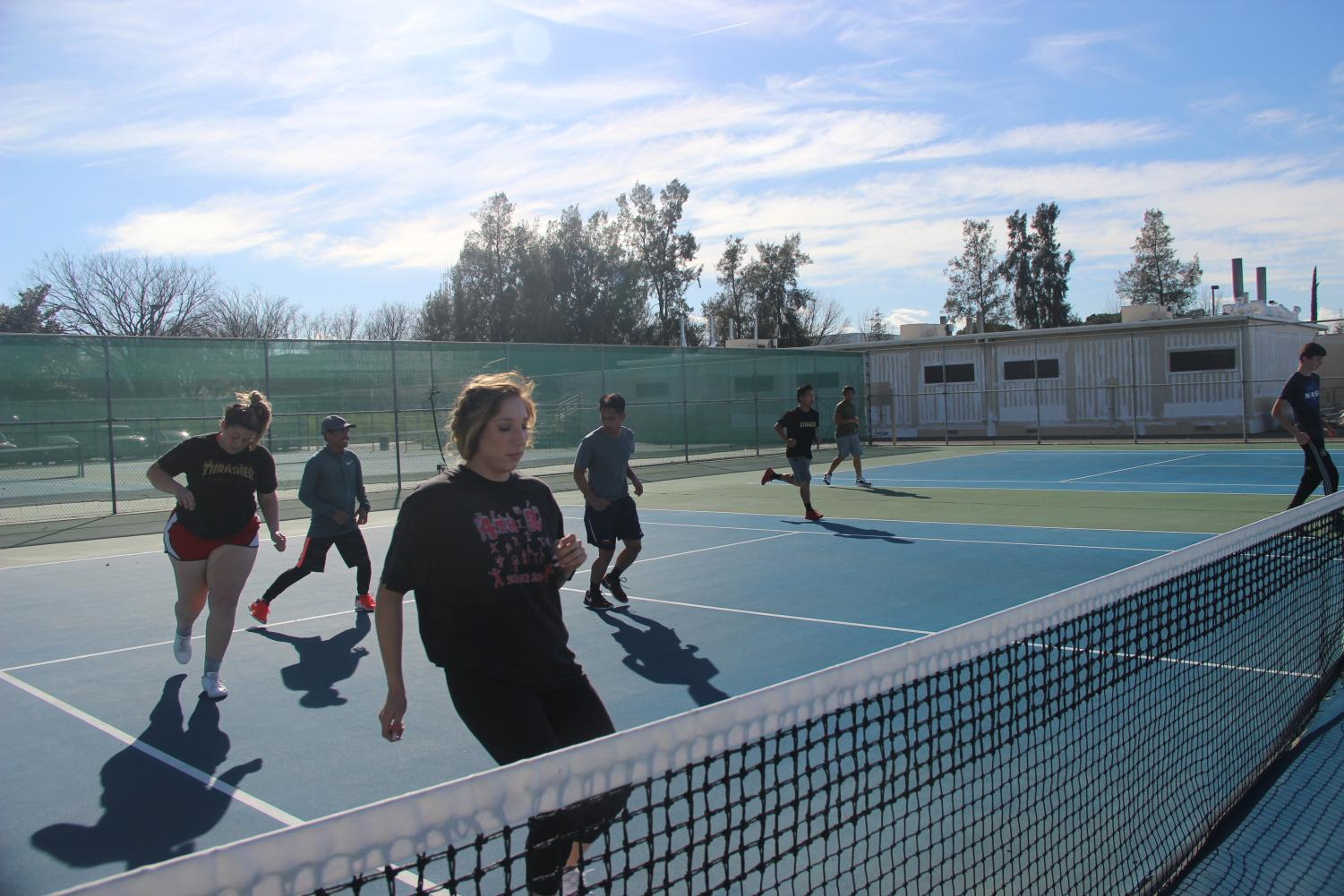 The Hawks' tennis teams practice together. The teams said condition would be a key factor to a successful season.