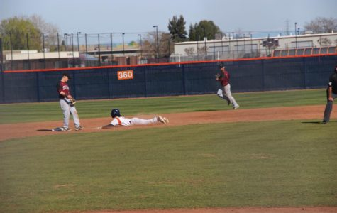 Hawks rally for eight runs late but fall to Wolverines