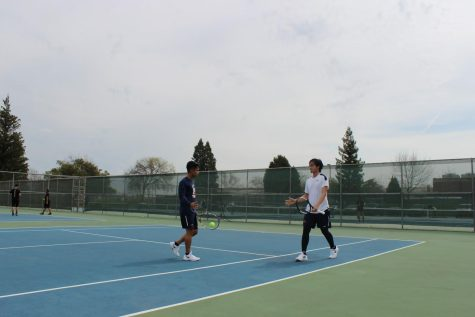 Freshmen Kien Dang (right) and Kyle Lopez (left) celebrate victory in their doubles match on March 19th. Dang and Lopez have been a strong team all year going 3-1 in their matches.