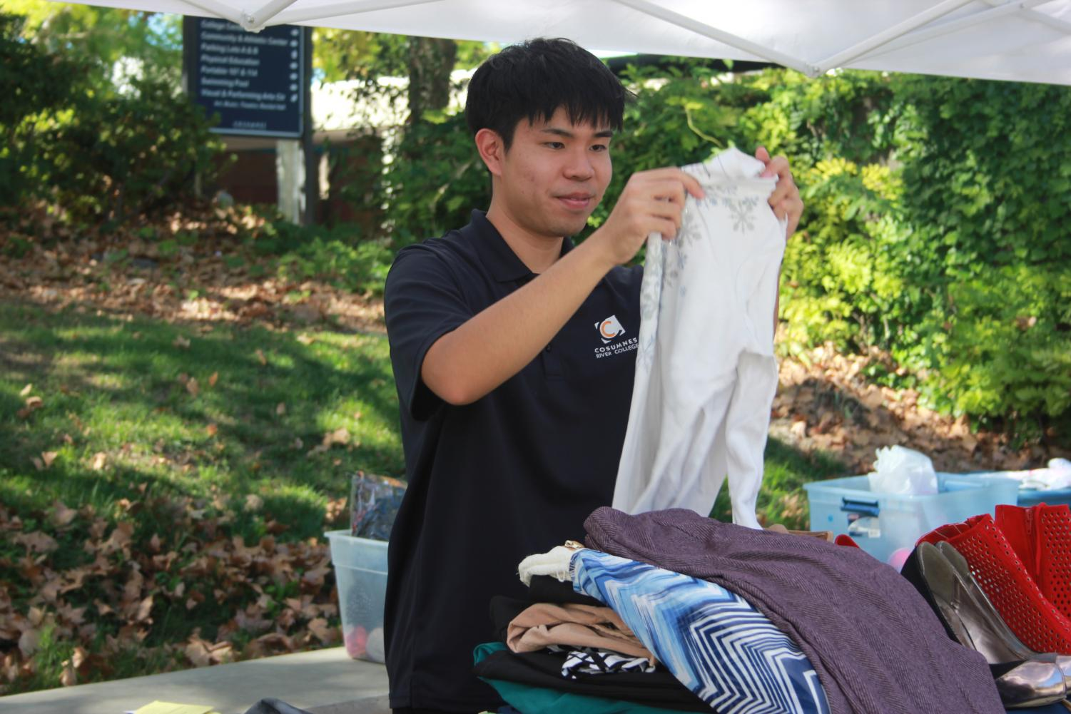 Jonathan Leong sorts through clothes for