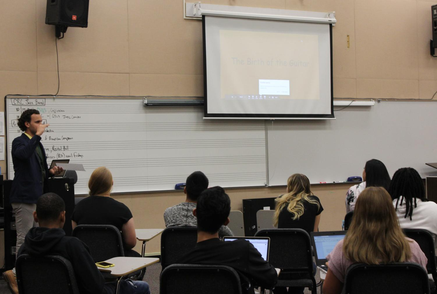 Professor Maxwell Kiesner prepares his Introduction to Music class for presentations on Sept. 18 in Music 306. Kiesner and other music faculty have introduced a new certificate this semester to train music teachers.