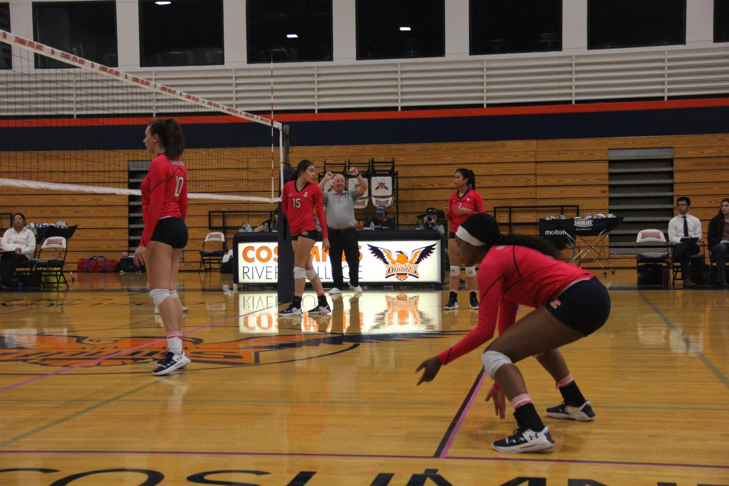 The Hawks get ready to counter a serve from the Diablo Valley Vikings. The Hawks won the game 21-25 against the Vikings on Oct. 15.