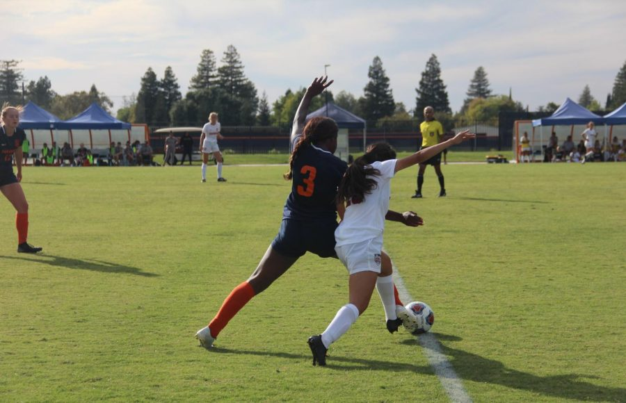 Sophomore right forward Obioma Onejeme number three steals the ball from the Sierra College defender. Onejeme, who started in eleven games, has scored five goals, one being a game-winning goal.