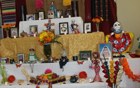 Photographs, candles, food and personal belongings are some of the objects placed on the ofrenda during Dia de Los Muertos. The Puente Club organized their own Dia De Los Muertos Community Celebration on Thursday.